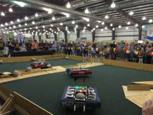 Team 1209 playing a demonstration match with Teams 3507 and 6026.