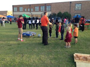 -Mr.Volle talking to a group of kids who were playing with the robot.